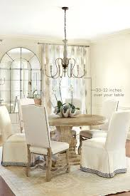 how high to hang light above dining room table on chandelier over dining room