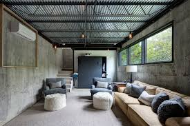 corrugated metal ceiling with concrete walls basement industrial and throw decorative pillows