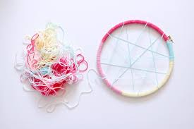 next cut 10 strands of yarn per color in your desired length keeping in mind that you will be folding them in half to tie onto the hoop