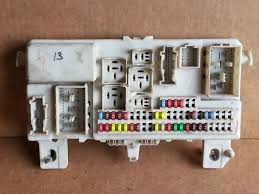 2007 mazda 3 bcm fuse box block panel used oem ban6 66730 e 2007 mazda 3 bcm fuse box block panel used oem ban6 66730 e ban666730e