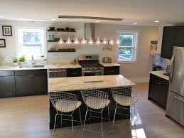 kitchen with black cabinets white subway tile backsplash open shelves instead of wall cabinets