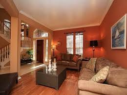 Mid-sized elegant medium tone wood floor living room photo in Raleigh with  brown walls