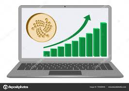 Iota Coin With Growth Chart On A Laptop Screen Stock