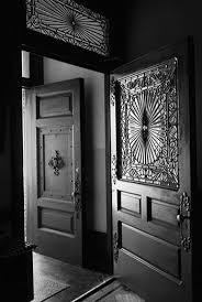 open door with a leaded glass window and transom and another open door in the background