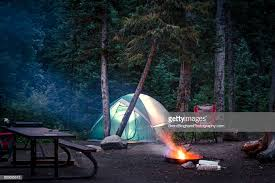 camping in the woods. Camping In The Woods With Tent And Fire : Stock Photo