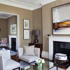 White furniture with taupe walls living room