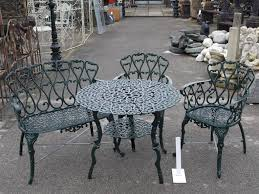 cast iron round table with shelf 2 chairs 1 bench