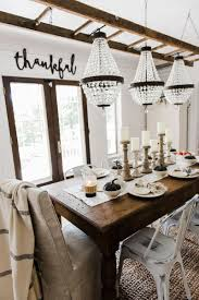 hang chandeliers from old ladder above dining room table beautiful dining room makeover via liz marie