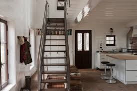 Inspiration for a rustic straight staircase remodel in Montreal