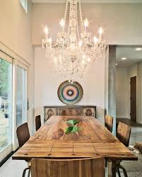 dining room crystal chandeliers rustic glam dining room eclectic with high ceilings swarovski