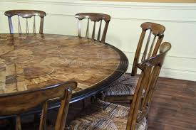 rustic dining room design with large round walnut dining room table walnut wood dining chairs