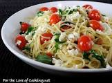 angel hair pasta with vegetables  pine nuts and feta cheese