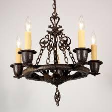 likeable cast iron chandelier on amazing antique five light figural tudor by virden