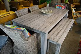 this large reclaimed teak dining table features a gray wash finish
