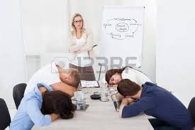 boring looking people. angry businesswoman looking at tired colleagues sleeping during presentation in office boring people e