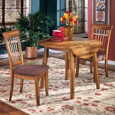Get the Ashley Furniture Berringer Round DRM Drop Leaf Table for the best  price online only at Jacku0027s Warehouse