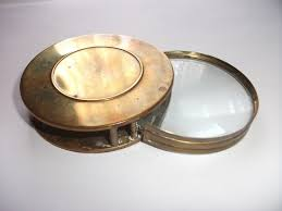 old brass cased folding magnifying glass