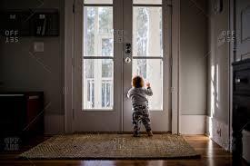 Image Inside Beachwood Doors Baby Looking Out Front Door Stock Photo Offset