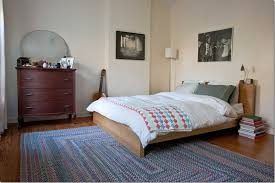 bed on exciting stroud braided rugs and nightstand