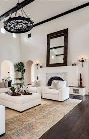 living room carolina design associates: keeping it simple with oversized furniture to keep the scale of the room in mind the height of the ceiling is matched by the equally impressive expanse of