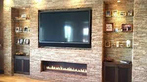 fireplace with tv above hanging above gas fireplace living room by flat screen electric fireplace tv
