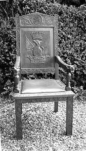 early 20th century chair made in eastern australia with strong heraldic embellishment
