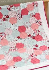 Large Hexagon Quilt Tutorial - The Polka Dot Chair Blog | Hexagon ... & Simple Hexagon Quilt: Half hexagons are stitched together in strips to  create the classic hexagon quilt pattern. Bold, beautiful, and perfect for  beginners. Adamdwight.com