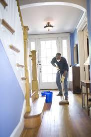 man mopping wood floor