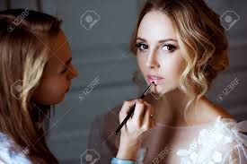 stock photo wedding makeup artist making a make up for bride