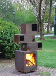 lit prometheus is an outdoor fireplace composed of corten steel the fluidity of fire contrasts with the sculptural hardness of the structure