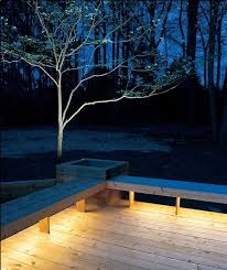 installing lights under benches bathes your deck in a warm glow rope lights