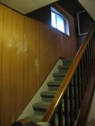 1970 s wood panelling lining a staircase going upstairs