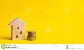 Real Estate Renting Coins And Wooden House On A Yellow Background Concept Of Real