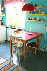 bright colored dining room chairs glass dining table and multi