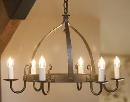 mitre 6 light round wrought iron chandelier in natural black with ivory candle s