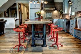 industrial kitchen furniture. brutal kitchen island pipe legs and cute red chairs are definitely a focal point of this industrial furniture