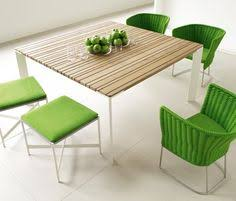 i love the sunset outdoor dining table and great green chairs again by paola lenti