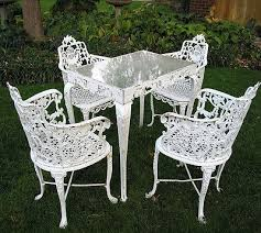 cast iron garden table and 4 chairs