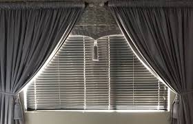 50mm venetian blind silver turned open with and matching curtains