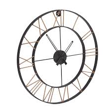 oversized metal skeleton wall clock with gold effect roman numerals and black metal hands