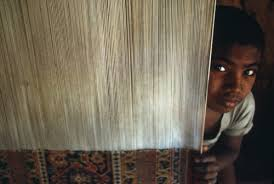 8 year old arvind weaves a carpet in a rat infested factory at mirzapur india throughout south asia nearly 300 000 children are forced to weave rugs for