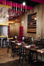 restaurant dining room design. dining room of a mexican restaurant featuring black spindle chairs and repurposed tables design s