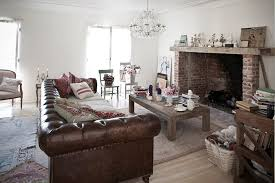 large leather chesterfield sofa sits at the heart of eclectic living room from rachel ashwell shabby chic couture decoist