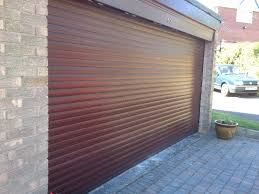dark wood effect insulated roller garage door