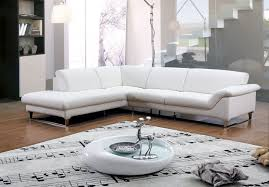 modern minimalist living room decoration with american white leather sectional sleeper sofa with chaise and wooden legs plus oval coffee table ideas