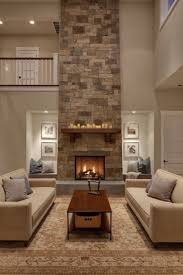 spacious living room cream sofa with great stone fireplace amazing siting nooks on both sides