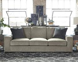 couch fabric types gray track arm sofa with dark pillows and a black chevron rug underneath