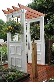 old doors converted into garden arbor
