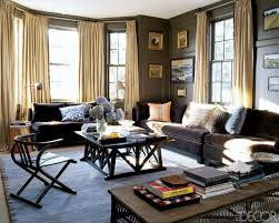 living room with dark sofa. interior designs,bright living room with brown sofa and book storage,modern celebrity house ideas : ali wentworth dark .
