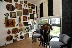 bedroomcolonial bedroom decor. Themed Chess Sets (above) That The Couple Collected As Travel Souvenirs Dot A Wall In Guest Room. Photo: Straits Times Bedroomcolonial Bedroom Decor I